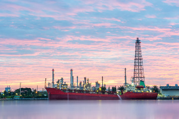 Foto op Plexiglas Berlijn Big red ship infront of Oil refinery factory at dawn, Oil refinery - Bangkok, Thailand