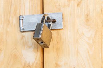 The padlock locking the wooden door, Security lock