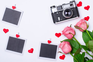 Romantic concept: roses, retro camera  and cards.