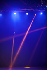 Illuminated empty theater stage with smoke