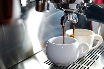 Espresso machine pouring coffee