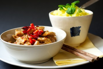 Spicy turkey meat, saffron rice, asian food.