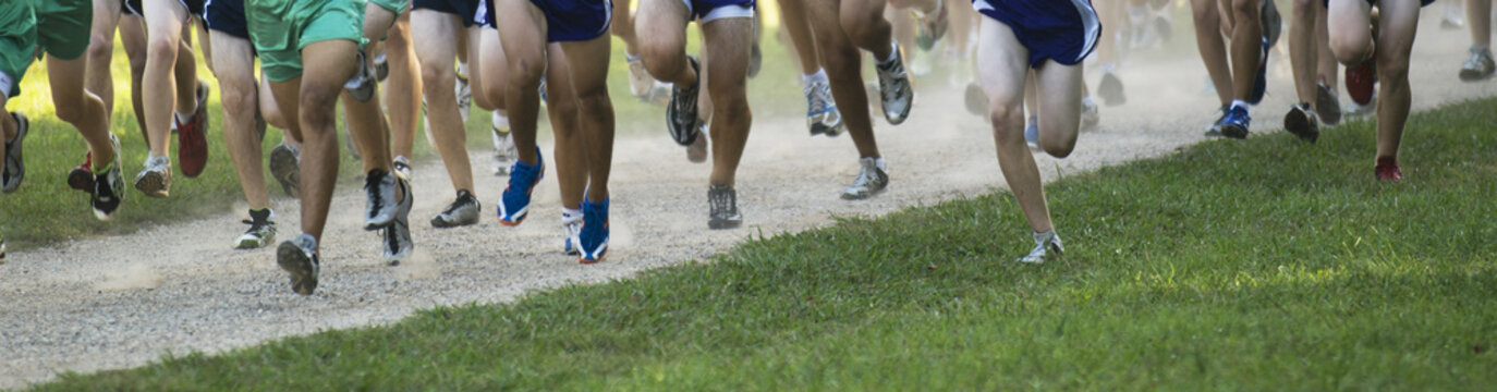 Panoramic view of runners legs and feet in a race