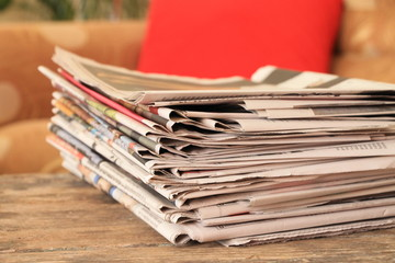 Newspapers on wooden table