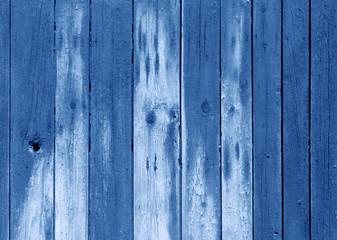 Wet blue color wooden fence pattern.