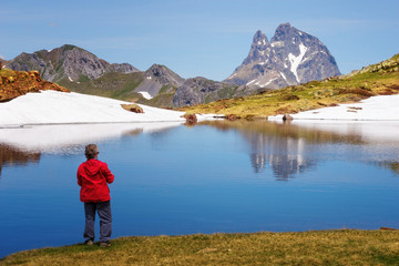 Beautiful landscape with the Midi d'Ossau reflecting in a lake, Parc national des Pyrenees, Spain.