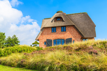 Wall Mural - Typical Frisian house with thatched roof on Sylt island in Westerheide village, Germany