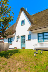 Fototapete - Typical white house with straw roof in Rantum village, Sylt island, Germany