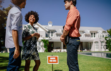 Real estate agent showing property to couple