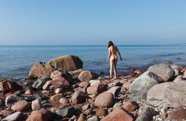 Naked girl outdoors enjoying nature
