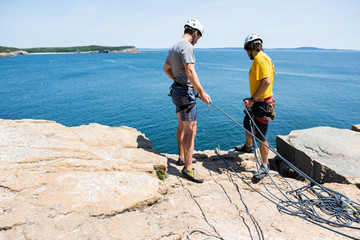 Two climbers looking over rock's edge