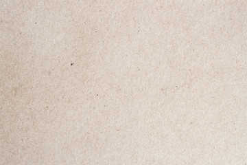 Paper texture cardboard background for design with copy space text or image. Recyclable material that looks virtually identical to the plain , but has small inclusions of cellulose