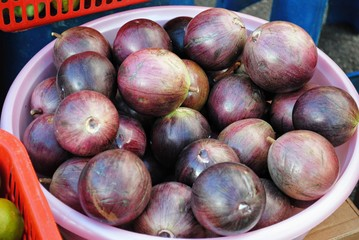 Purple star apple fruits A basin full of freshly picked star apple fruits all ripe and ready to eat