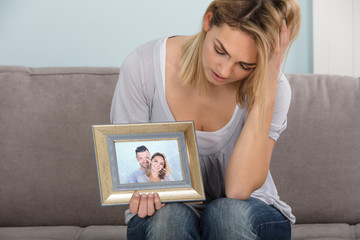 Unhappy Woman Holding Picture Frame