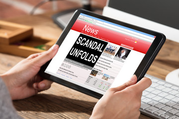Woman Reading Scandal News On Digital Tablet