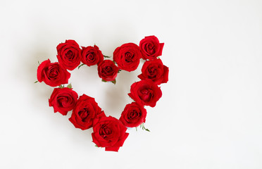 Heart Shaped Red Rose Arrangement on a White Background