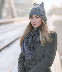 Portrait of young woman at sunny winter day.