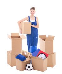 moving day concept - young woman in workwear with cardboard boxes isolated on white