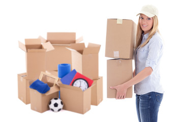 moving day concept - attractive woman with brown cardboard boxes with stuff isolated on white