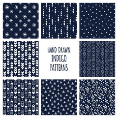 Set of hand drawn indigo blue and white patterns. Seamless vector triblal aztec backgrounds with triangles and arrows.