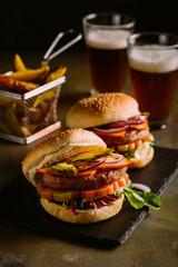 Gourmet burger on dark wooden background