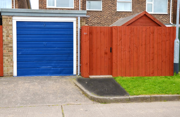 smi detached house with garage and high fence