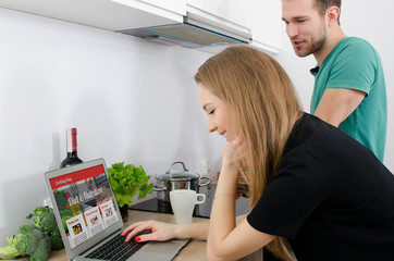 Young couple cooking together in the kitchen.