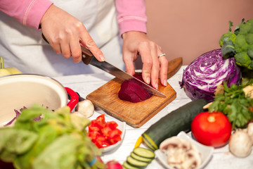 Woman cutting beetroot