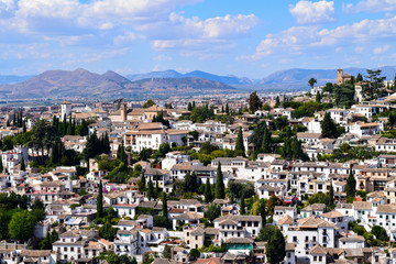 White houses of El Albayzin neighbourhood over the hills of Granada in Andalusia, Spain