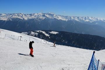 Snowboarders on the ski track in Rosa Khutor