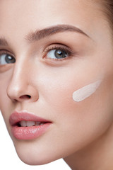 Skin Care. Sexy Girl With Liquid Foundation Stripe On Face