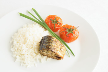 mackerel with rice and tomatoes decorated with green onion