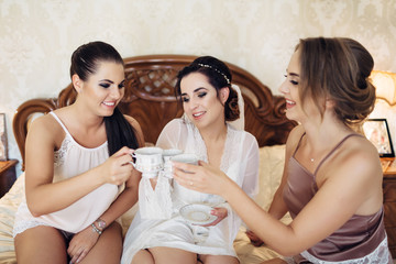 The bride and bridesmaids keeping cups of tea
