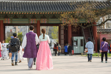 Couple in traditional Korean walk in the vintage temple