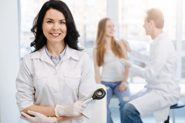 Happy young patient having conversation with dermatologist the hospital