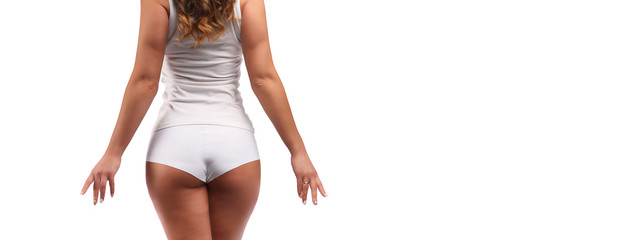 part of young tanned woman body with cotton panties isolated on white, back side