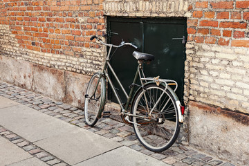 Bicycle by brick wall