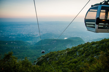2016 Albania Tirana view from Dali moutain to the city. Line trolleyin an evening sun