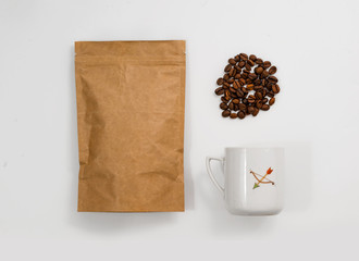 Vintage cup of coffee on white, pack coffee and coffee grains. Hipster background.