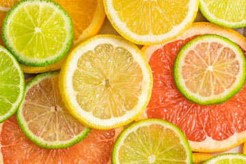 Grapefruit, lime, lemon, and orange slices background