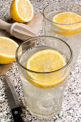refreshment drink, sparkling mineral water with lemon juice on ice