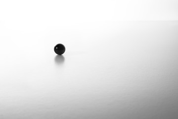 black ball on a white table