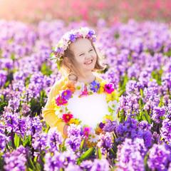 Wall Mural - Little girl in hyacinth field