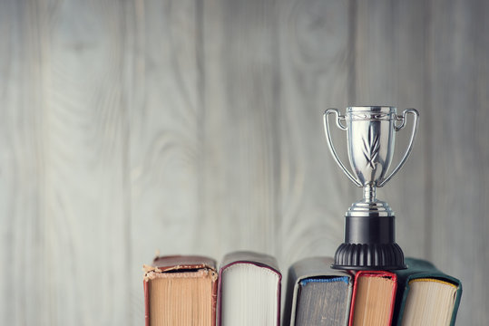 Books and sports cup