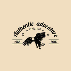 Vector tribal camp logo.Tourist sign with hand drawn image of american eagle.Retro hipster emblem of outdoor adventures.