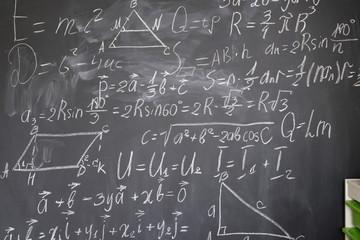 math formulas in white chalk on black board