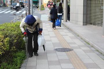 Old man walking home at Tokyo Japan
