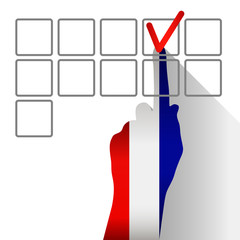 Elections in France. The hand votes the check-box for the candidate. Silhouette of hand made up of the colors of the flag.