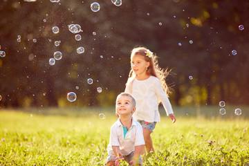 Boy amazingly look at soap bubbles