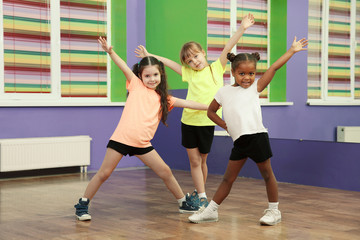 Cute little girls dancing in choreography class